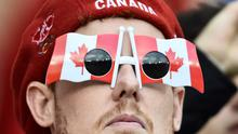 A Canada fan waits for kick off of the Pool D match of the 2015 Rugby World Cup between Canada and Romania at Leicester City Stadium in Leicester, central England, on October 6, 2015.  AFP PHOTO / BERTRAND LANGLOIS