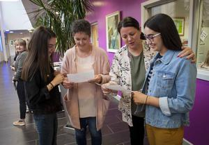 St. Mary's College, Derry students Jane McGowan and her mum Catherine and Jayne McSherry and her mum Seana check their A Level results at the school yesterday morning.