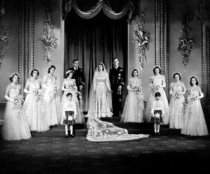 File photo dated 20/11/1947 Princess Elizabeth, now Queen, and Lieutenant Philip Mountbatten, now the Duke of Edinburgh with their eight bridesmaids in the Throne Room at Buckingham Palace, on their wedding day. PRESS ASSOCIATION Photo. The Queen and Duke of Edinburgh will mark their diamond wedding anniversary with a special service of thanksgiving next week. Retracing their footsteps down the aisle, the royal couple will return to Westminster Abbey, where they married 60 years ago. See PA Story ROYAL Anniversary. Photo credit should read: PA Wire