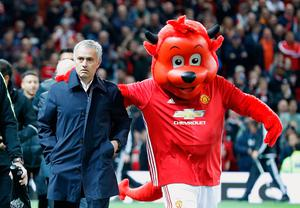 Manchester United manager Jose Mourinho with mascot Fred The Red before the EFL Cup, round of 16 match at Old Trafford, Manchester. PA