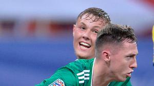 Red and Whyte: Gavin Whyte is congratulated by Daniel Ballard after his equaliser for 10-man Northern Ireland