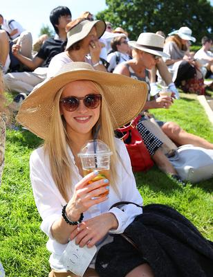 Penny from London enjoying the weather, during day one of the Wimbledon Championships at the All England Lawn Tennis and Croquet Club, Wimbledon. PRESS ASSOCIATION Photo. Picture date: Monday June 29, 2015.  See PA Story TENNIS Wimbledon. Photo credit should read  Philip Toscano/PA Wire. RESTRICTIONS: Editorial use only. No commercial use without prior written consent of the AELTC. Still image use only - no moving images to emulate broadcast. No superimposing or removal of sponsor/ad logos. Call +44 (0)1158 447447 for further information.