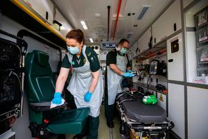 Student EMT Ruth Corscadden and paramedic Daniel McCollam cleaning their ambulance after bringing a patient to the Causeway Hospital earlier this month