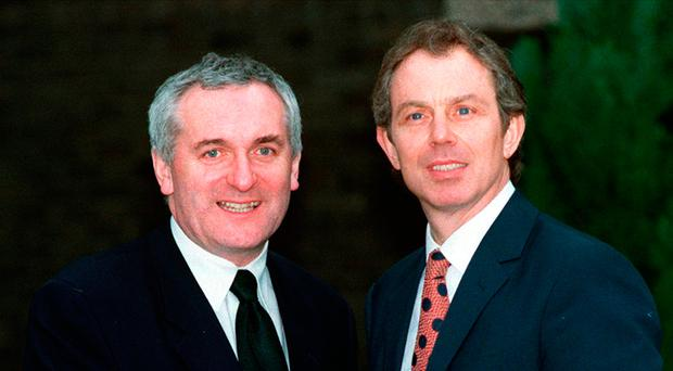 Prime Minister Tony Blair and Taoiseach Bertie Ahern shake hands after the Good Friday Agreement was signed in April 1998