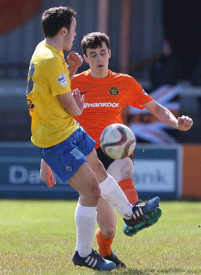 Cleaning up: Danny Wallace clears from Jonny Frazer