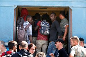 "This handout photograph taken and released by Caritas Internationalis on September 5, 2015 in Gevgelija, shows migrants getting on board a train for Serbia, at the border between Greece and Macedonia. More than 230,000 refugees and migrants have arrived in Greece by sea this year, a huge rise from 17,500 in the same period in 2014, shipping ministry said on September 3. AFP PHOTO / CARITAS INTERNATIONALIS / MATTHIEU ALEXANDRE  -- EDITORS NOTE -- RESTRICTED TO EDITORIAL USE - MANDATORY CREDIT ""AFP PHOTO/ MATTHIEU ALEXANDRE/CARITAS INTERNATIONALIS"" - NO MARKETING NO ADVERTISING CAMPAIGNS ----CAR04MATTHIEU ALEXANDRE/AFP/Getty Images"
