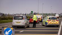 Police officers set up a checkpoint on the Frosses Road heading towards Portrush to ensure coronavirus restrictions are followed.  (Photo by Kevin Scott for Belfast Telegraph)