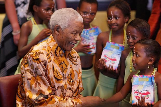 CAPE TOWN, SOUTH AFRICA - APRIL 03:  Nelson Mandela meets children after they had performed during a lunch to Benefit the Mandela Children's Foundation as part of the celebrations of the opening of the new One&Only Cape Town resort on April 3, 2009 in Cape Town, South Africa. The One&Only is Sol Kerzner's first hotel in his home country since 1992. The 130 room property is One&Only's first urban resort and sits in the fashionable Waterfront district. Celebrities from all over the world including Mariah Carey, Clint Eastwood, Matt Damon, Morgan Freeman, Thandie Newton and Marisa Tomei will attend the event. Gordon Ramsay will be launching his first restaurant in Africa at the resort, Maze and Robert De Niro will be opening Nobu. Nelson Mandela will be attending an intimate luncheon at Maze on Friday to celebrate his long-standing relationship with Mr. Kerzner.  (Photo by Chris Jackson/Getty Images) *** Local Caption *** Nelson Mandela