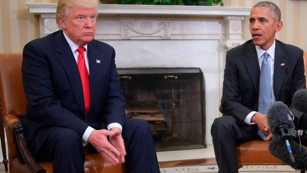US President Barack Obama meets with President-elect Donald Trump to update him on transition planning in the Oval Office at the White House on November 10, 2016 in Washington,DC.  / AFP PHOTO / JIM WATSONJIM WATSON/AFP/Getty Images