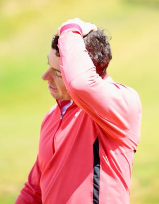 NEWCASTLE, NORTHERN IRELAND - MAY 28:  Rory McIlroy of Northern Ireland reacts on the 9th green during the First Round of the Dubai Duty Free Irish Open Hosted by the Rory Foundation at Royal County Down Golf Club on May 28, 2015 in Newcastle, Northern Ireland.  (Photo by Andrew Redington/Getty Images)