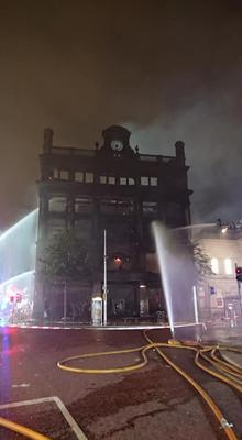 Firefighters tackling Primark fire. Credit: NIFRS