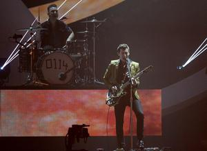 The Arctic Monkeys on stage during the 2014 Brit Awards at the O2 Arena, London