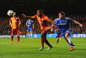 LONDON, ENGLAND - MARCH 18:  Didier Drogba of Galatasaray holds off Cesar Azpilicueta of Chelsea during the UEFA Champions League Round of 16 second leg match between Chelsea and Galatasaray AS at Stamford Bridge on March 18, 2014 in London, England.  (Photo by Mike Hewitt/Getty Images)