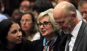 From left, Oscar Pistorius' sister Aimee, his aunt Lois, and uncle Arnold wait for the start of his trial at the high court in Pretoria, South Africa, Monday, March 3, 2014. Pistorius is charged with murder with premeditation in the shooting death of girlfriend Reeva Steenkamp in the pre-dawn hours of Valentine's Day 2013. (AP Photo/Themba Hadebe, Pool)