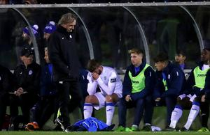 Paddy McCourt reacts after being taken off with an injury in his final match.