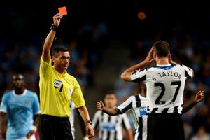 MANCHESTER, ENGLAND - AUGUST 19:  Referee Andre Marriner shows the red card to Steven Taylor of Newcastle United during the Barclays Premier League match between Manchester City and Newcastle United at the Etihad Stadium on August 19, 2013 in Manchester, England.  (Photo by Michael Regan/Getty Images)