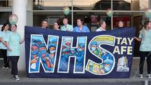 Staff outside Belfast City Hospital's tower block, which is Northern Ireland's first Nightingale Hospital, hold a short event at 8.00pm on Thursday April 16 to recognise and acknowledge the public support during a Clap for Blue Light Services. Photo by Kelvin Boyes  / Press Eye.