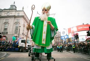 A mobile figure of St. Patrick at the Mayor of London's St Patrick's Day Parade and Festival in London. Daniel Leal-Olivas/PA Wire.