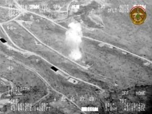 FILE - This still image from black and white gun camera video made by the Iraqi Ministry of Defense on Wednesday, June 11, 2014, shows what the ministry says are airstrikes on fighters of the Islamic State of Iraq and the Levant in an area near Mosul in Nineveh province, Iraq. The militants' capture of Iraqs cities of Mosul and Tikrit makes their dream of a new Islamic state look more realistic. It already controlled a swath of eastern Syria along the Euphrates River, with a spottier presence extending further west nearly to Aleppo, Syrias largest city. In Raqqa, the biggest city it holds in Syria, it imposes taxes, rebuilds bridges and enforces the law _ its strict version of Shariah. (AP Photo/Iraqi Ministry of Defense)