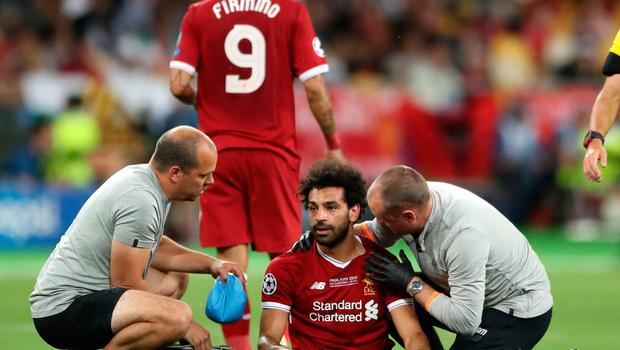 Liverpool's Mohamed Salah reacts after picking up an injury during the UEFA Champions League Final at the NSK Olimpiyskiy Stadium, Kiev. PRESS ASSOCIATION Photo. Picture date: Saturday May 26, 2018. See PA story SOCCER Champions League. Photo credit should read: Nick Potts/PA Wire