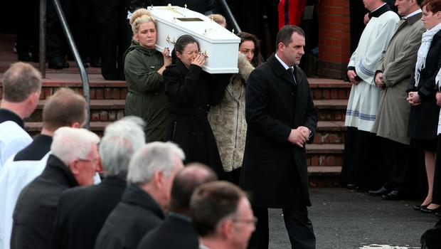Louise James (front left) who lost her partner, two sons, sister and mother carries a coffin out of the Holy Family church, Ballymagroarty in Londonderry after the funeral of the five people who were killed when their car slid off a slipway in Co Donegal. PRESS ASSOCIATION Photo. Picture date: Thursday March 24, 2016. Sean McGrotty and his sons Mark, 12, and Evan, eight, died along with his mother-in-law Ruth Daniels, 57, and her 14-year-old daughter Jodie Lee Daniels after their SUV sank after sliding off the pier slipway in Buncrana, Co Donegal. See PA story FUNERAL Pier. Photo credit should read: Brian Lawless/PA Wire
