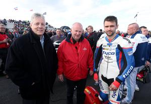 Photographer ©Matt Mackey - Presseye.com  14th May 2015  North West 200 Thursday races around the International North West 200 circuit.  First Minister Peter Robinson chats to Race Director Mervyn Whyte and Tyco racer William Dunlop on the grid.