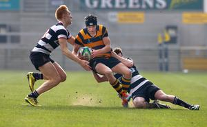 17th March 2015   ?William Cherry/Presseye  RBAI?s Jack Conlin with Wallace High School?s Connor Guiney and Andrew Cardosi during the Danske Bank Ulster Schools? Cup final at the Kingspan Stadium.