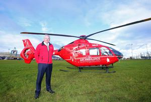 Press Eye Belfast - Northern Ireland 9th November 2016  One of the two helicopters which will deliver Northern IrelandÕs first ever Helicopter Emergency Medical Service (HEMS) is in Northern Ireland for a three-day flying visit.   Pictured with the Airbus helicopter is Air Ambulance Northern Ireland Chairman Ian Crowe.  Picture by Jonathan Porter/Press Eye
