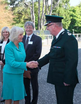 Police Service of Northern Ireland Chief Constable George Hamilton  greets the Duchess of Cornwall as she attends the PSNI HQ memorial garden opening in Belfast, during their visit to Northern Ireland. Brian Lawless/PA Wire
