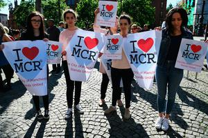 Members of the public gather to attend a candlelit vigil, to honour the victims of Monday evening's terror attack, at Albert Square on May 23, 2017 in Manchester, England. (Photo by Jeff J Mitchell/Getty Images)