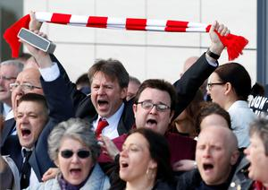 Relatives of those who died in the Hillsborough disaster sing You'll Never Walk Alone outside the Hillsborough Inquest in Warrington. Pic: Owen Humphreys/PA Wire