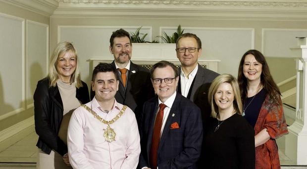 Lord Mayor of Belfast, Councillor Daniel Baker; Professor Ian Greer; President and Vice-Chancellor of Queen's University Belfast; and Grainia Long, Commissioner for Resilience, Belfast City Council and Co-chair of the Belfast Climate Commission. Back row (L-R): Suzanne Wylie, Chief Executive, Belfast City Council; Professor John Barry, Professor of Green Political Economy at Queen's University Belfast and Co-chair of the Belfast Climate Commission; Professor Andy Gouldson, Chair of the Leeds Climate Commission and a co-investigator for PCAN; and Dr Amanda Slevin, PCAN Policy Fellow at Queen's University Belfast.
