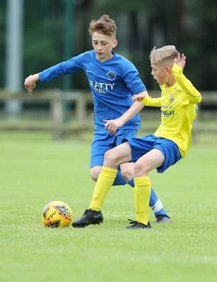 PressEye-Northern Ireland- 29th July  2019-Picture by Brian Little/PressEye Dungannon United Elijah Weathered and Ballinamallard United Ethan Abercrombie  in the Minor section of the STATSports SuperCupNI , at University, Coleraine. Picture by Brian Little/PressEye