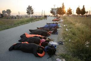 "This handout photograph taken and released by Caritas Internationalis on September 5, 2015 in Idomeni, northern Greece, shows migrants sleeping on the road as they wait to be allowed to cross the Greek-Macedonian border. More than 230,000 refugees and migrants have arrived in Greece by sea this year, a huge rise from 17,500 in the same period in 2014, shipping ministry said on September 3. AFP PHOTO / CARITAS INTERNATIONALIS / MATTHIEU ALEXANDRE  -- EDITORS NOTE -- RESTRICTED TO EDITORIAL USE - MANDATORY CREDIT ""AFP PHOTO/ MATTHIEU ALEXANDRE/CARITAS INTERNATIONALIS"" - NO MARKETING NO ADVERTISING CAMPAIGNS ----CAR04MATTHIEU ALEXANDRE/AFP/Getty Images"