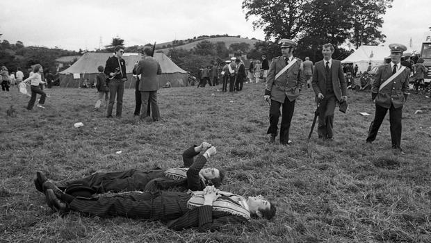 I love this photo of two young Orangemen relaxed enough to lie back and contemplate the sky after the parade.