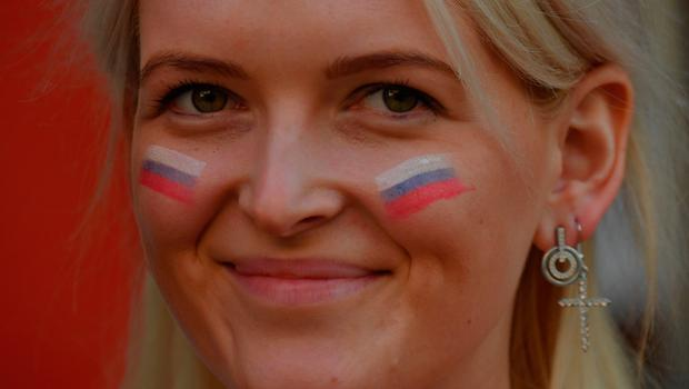 A Russian fan poses in Ekaterinburg on June 19, 2018 during the Russia 2018 World Cup football tournament. / AFP PHOTO / HECTOR RETAMALHECTOR RETAMAL/AFP/Getty Images