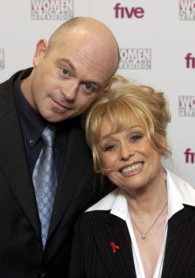 The actress with EastEnders co-star Ross Kemp (Myung Jung Kim/PA)