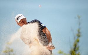 KAVARNA, BULGARIA - MAY 15:  Graeme McDowell of Northern Ireland plays from a bunker during the pro am event prior to the Volvo World Match Play Championship at Thracian Cliffs Golf & Beach Resort on May 15, 2013 in Kavarna, Bulgaria.  (Photo by Ross Kinnaird/Getty Images)