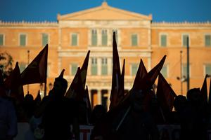 ATHENS, GREECE - JULY 02:  Greek Communist Party supporters listen to speeches during a rally in Syntagma Square near the Parliament on July 2, 2015 in Athens, Greece. As people continue to queue outside banks Greek finance minister Yanis Varoufakis said that he will quit if voters don't back him up in Sunday's referendum.  (Photo by Christopher Furlong/Getty Images)