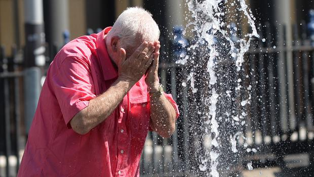 Pacemaker Press 28/06/2018  Cooling  down at the water fountain  during the hot weather in Belfast on Thursday, that is thought to be the hottest day of the year, as the sunshine continues. Pic Colm Lenaghan/Pacemaker