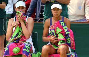 LONDON, ENGLAND - JUNE 26:  Anne Keothavong and Johanna Konta of Great Britain look on during a break in their Ladies' Doubles first round match against Sara Errani of Italy and Roberta Vinci of Italy on day three of the Wimbledon Lawn Tennis Championships at the All England Lawn Tennis and Croquet Club on June 26, 2013 in London, England.  (Photo by Julian Finney/Getty Images)