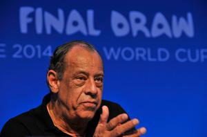 (FILES) This file photo taken on December 05, 2013 shows Brazilian football legend Carlos Alberto Torres giving a press conference on the eve of the Brazil 2014 FIFA Football World Cup final draw, in Costa do Sauipe, state of Bahia, on December 5, 2013. Carlos Alberto, captain of the great Brazil team that won the 1970 World Cup, dies on Tuesday of a heart attack in Rio at the age of 72, Brazil's Sportv, for whom he worked, announced. / AFP PHOTO / NELSON ALMEIDANELSON ALMEIDA/AFP/Getty Images