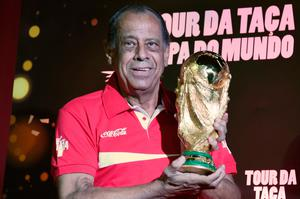 (FILES) This file photo taken on April 22, 2014 shows Carlos Alberto, former captain of the Brazilian 1970's football team, holds the World Cup which has just arrived in the country, at Maracana stadium in Rio de Janeiro, Brazil on April 22, 2014.    Carlos Alberto, captain of the great Brazil team that won the 1970 World Cup, dies on October 25, 2016 of a heart attack in Rio at the age of 72, Brazil's Sportv, for whom he worked, announced. / AFP PHOTO / CHRISTOPHE SIMONCHRISTOPHE SIMON/AFP/Getty Images