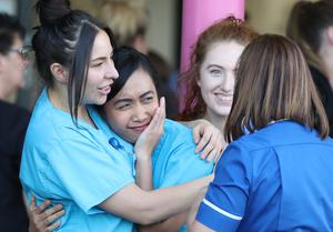 NHS staff from Aintree University Hospital in Liverpool react during the applause (Peter Byrne/PA)