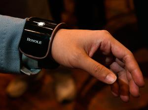 LAS VEGAS, NV - JANUARY 04:  Royole Corp. CEO Zihong Liu demonstrates a Royole FlexPhone that is flexible enough to bend around one's wrist during a press event for CES 2017 at the Mandalay Bay Convention Center on January 4, 2017 in Las Vegas, Nevada. CES, the world's largest annual consumer technology trade show, runs from January 5-8 and is expected to feature 3,800 exhibitors showing off their latest products and services to more than 165,000 attendees.  (Photo by Ethan Miller/Getty Images)