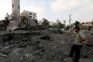 A Palestinian man inspects the Al Aqsa Martyrs mosque destroyed by an overnight Israeli strike, in Gaza City, Tuesday, July 22, 2014 (AP Photo/Lefteris Pitarakis)