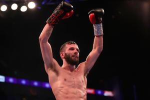Job done: Anthony Cacace celebrates his points victory