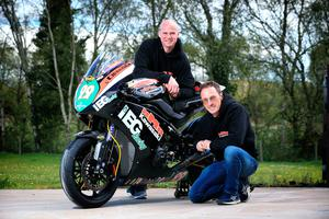 Ryan Farquhar (back), along with Jeremy McWilliams, with one of their KMR Racing team bikes