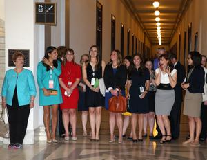 WASHINGTON, DC - MAY 09:  Women await the arrival of HRH Prince Harry before he tours an anti-landmine photography exhibition by The HALO Trust charity during the first day of his visit to the United States at the Russell Senate Office Building on May 9, 2013 in Washington, DC. HRH will be undertaking engagements on behalf of charities with which the Prince is closely associated on behalf also of HM Government, with a central theme of supporting injured service personnel from the UK and US forces.  (Photo by Chris Jackson-Pool/Getty Images)
