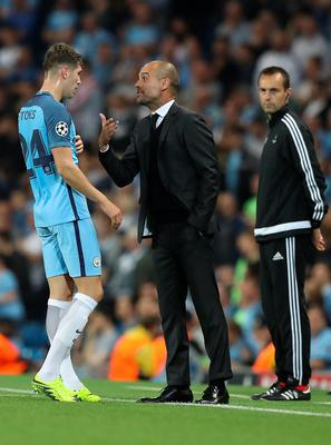 Manchester City manager Pep Guardiola speaks with John Stones during the Champions League match at the Etihad Stadium, Manchester. PRESS ASSOCIATION Photo. Picture date:  Wednesday September 14, 2016. See PA story SOCCER Man City. Photo credit should read: Martin Rickett/PA Wire